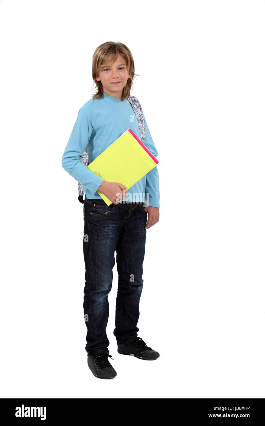 Schoolboy holding folders - Stock Image