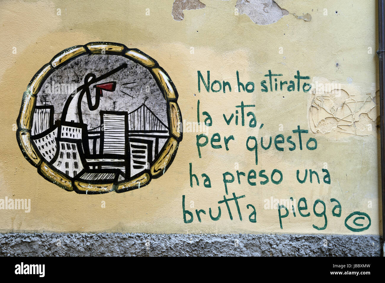 Graffiti on a wall in Pise, Italy Stock Photo
