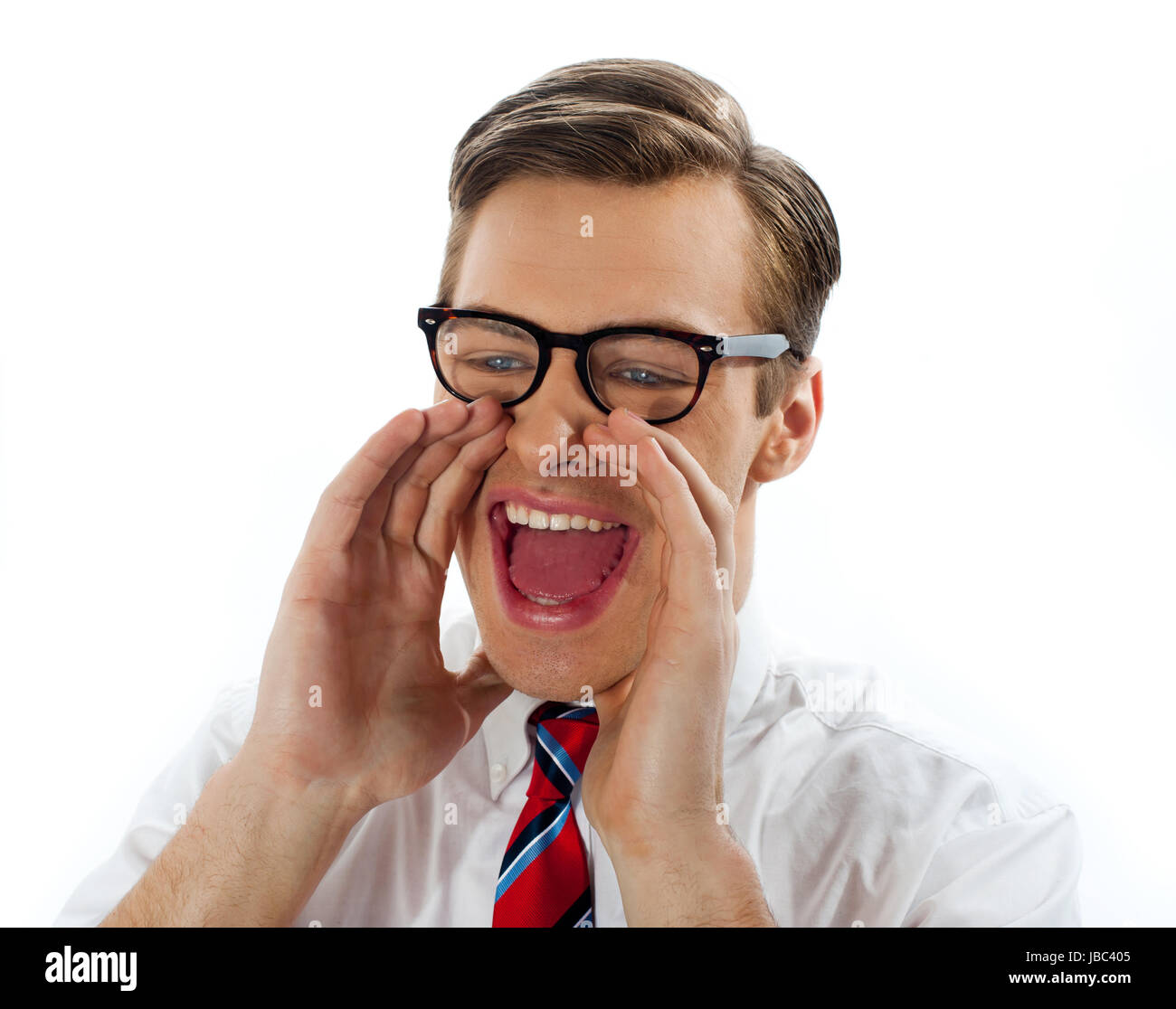 Excited businessman with glasses shouting loudly - Stock Image