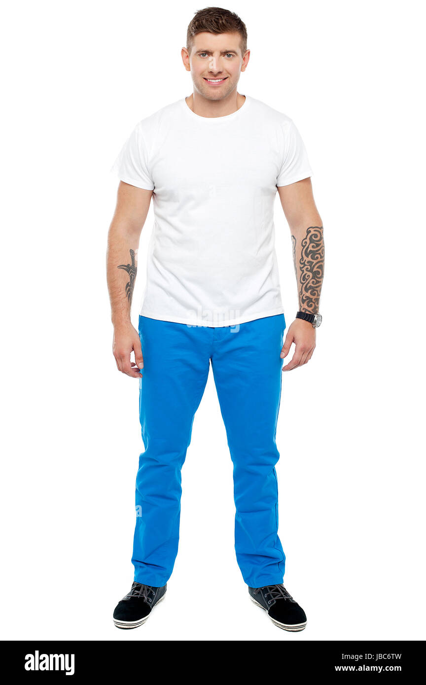 fc69e995e Handsome guy with tattoos posing casually isolated against white background  - Stock Image