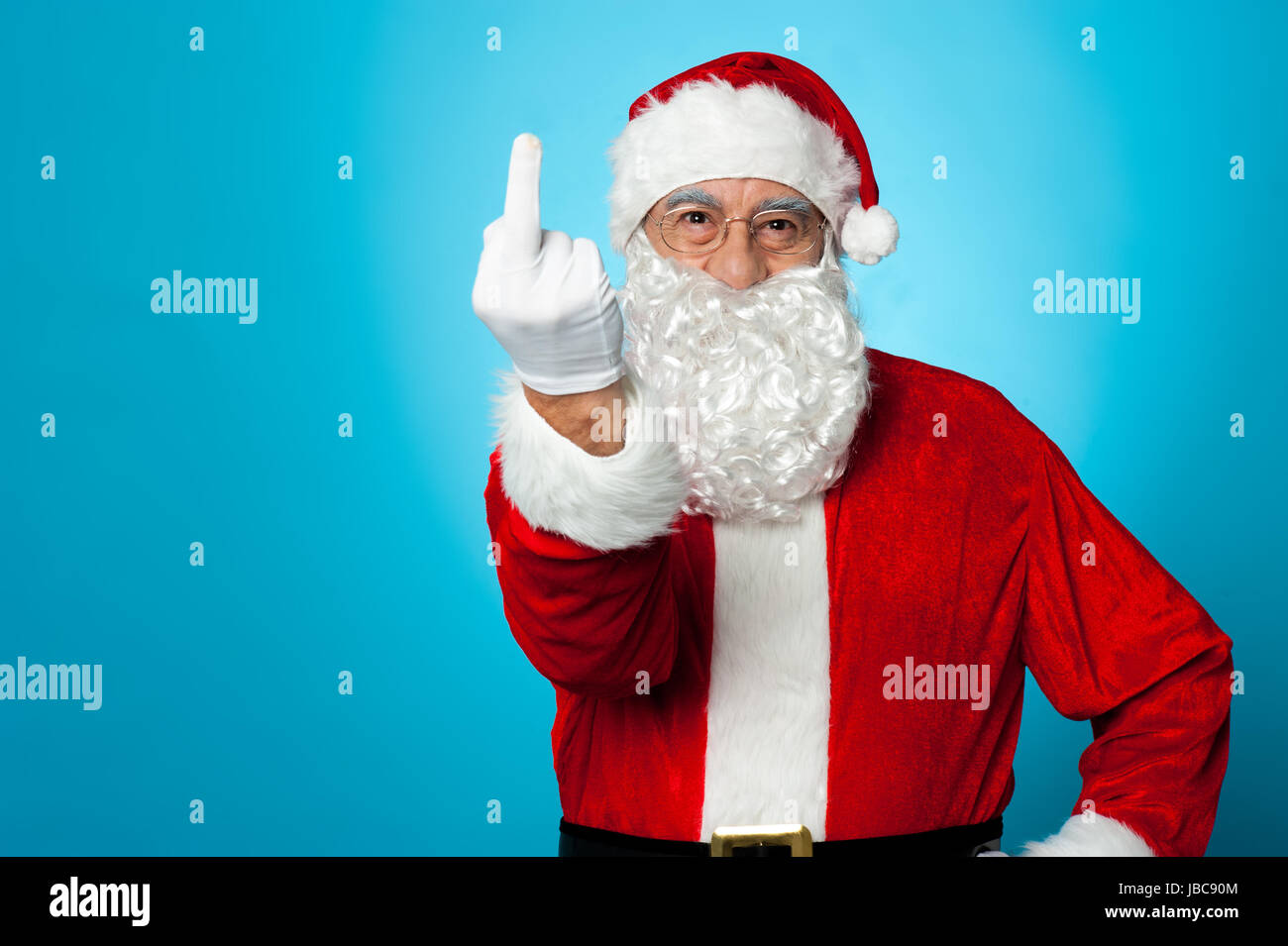 Agitated Santa showing his middle finger to the camera Stock Photo