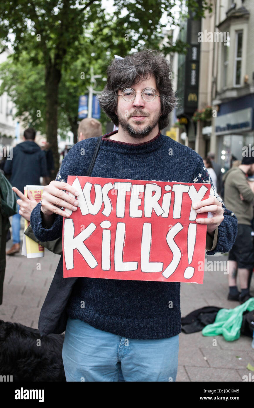 Cardiff, UK. 10th June, 2017. Adam Johannes holding austerity kills sign. Calling for Conservative Prime Minister Stock Photo