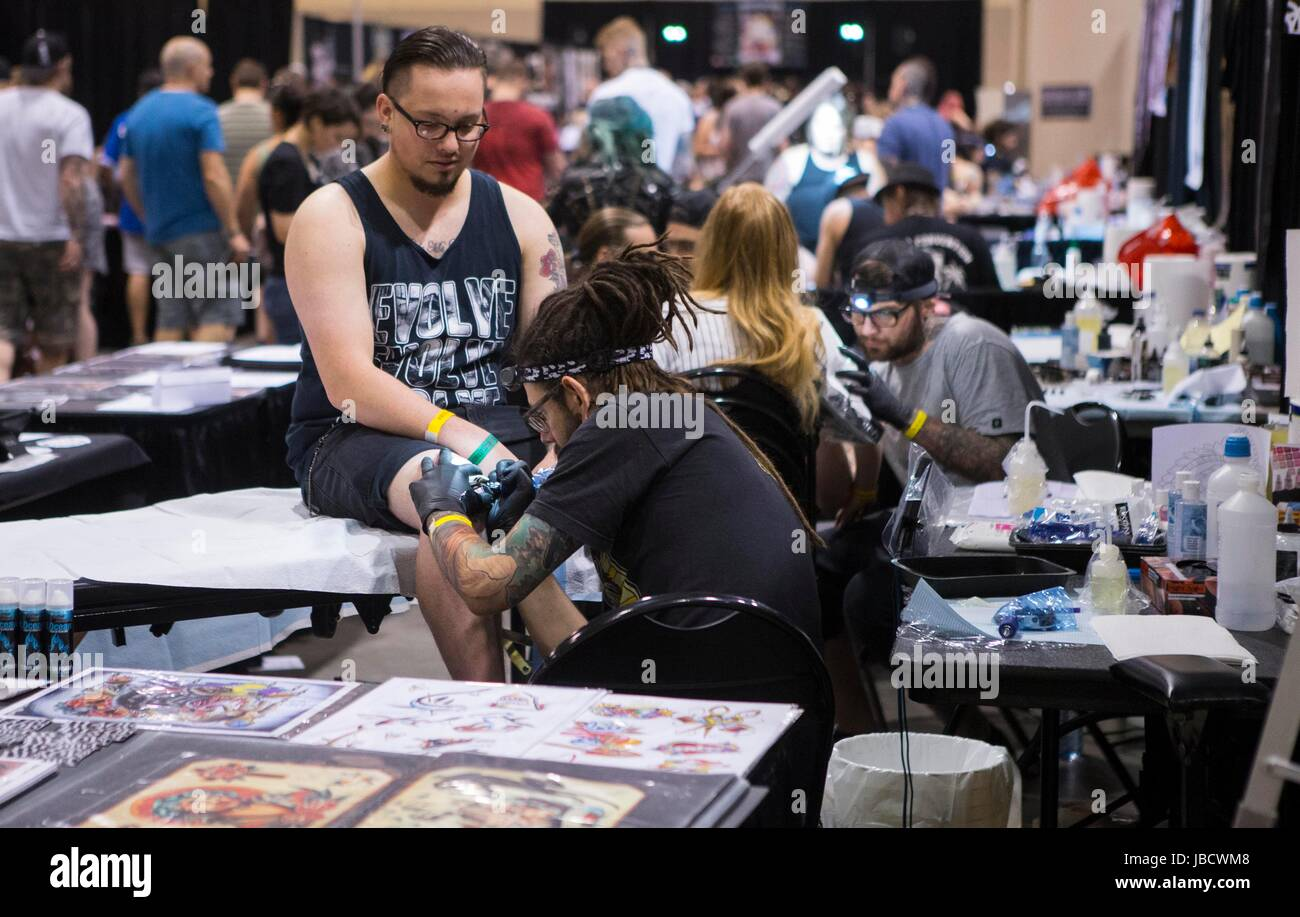 Toronto, Canada. 10th June, 2017. People visit the 2017 Toronto Tattoo Show in Toronto, Canada, June 10, 2017. Over - Stock Image