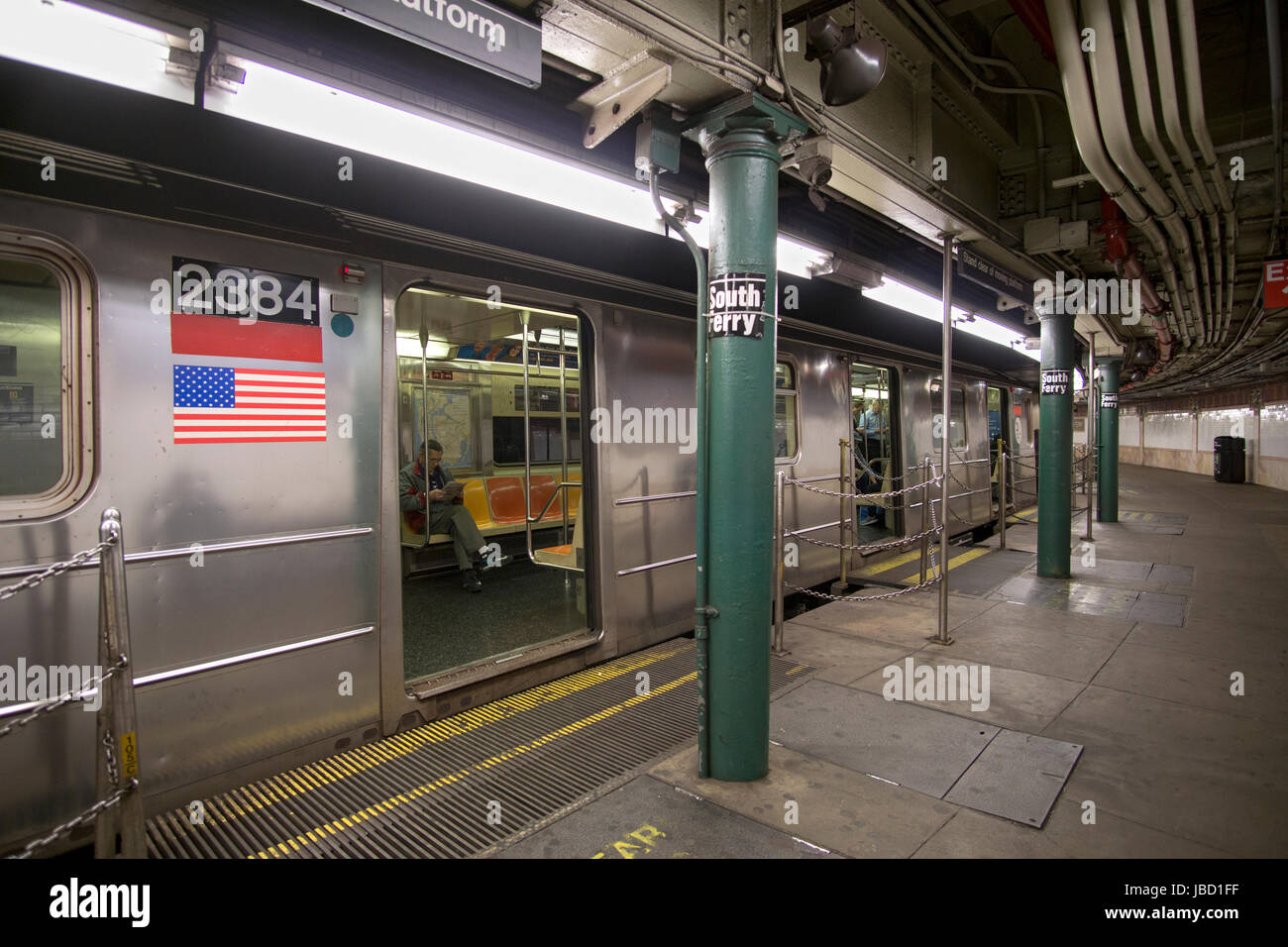A subway trains at the South Ferry station, the last stop on the IRT number 1 train. In battery PArk, downtown, - Stock Image
