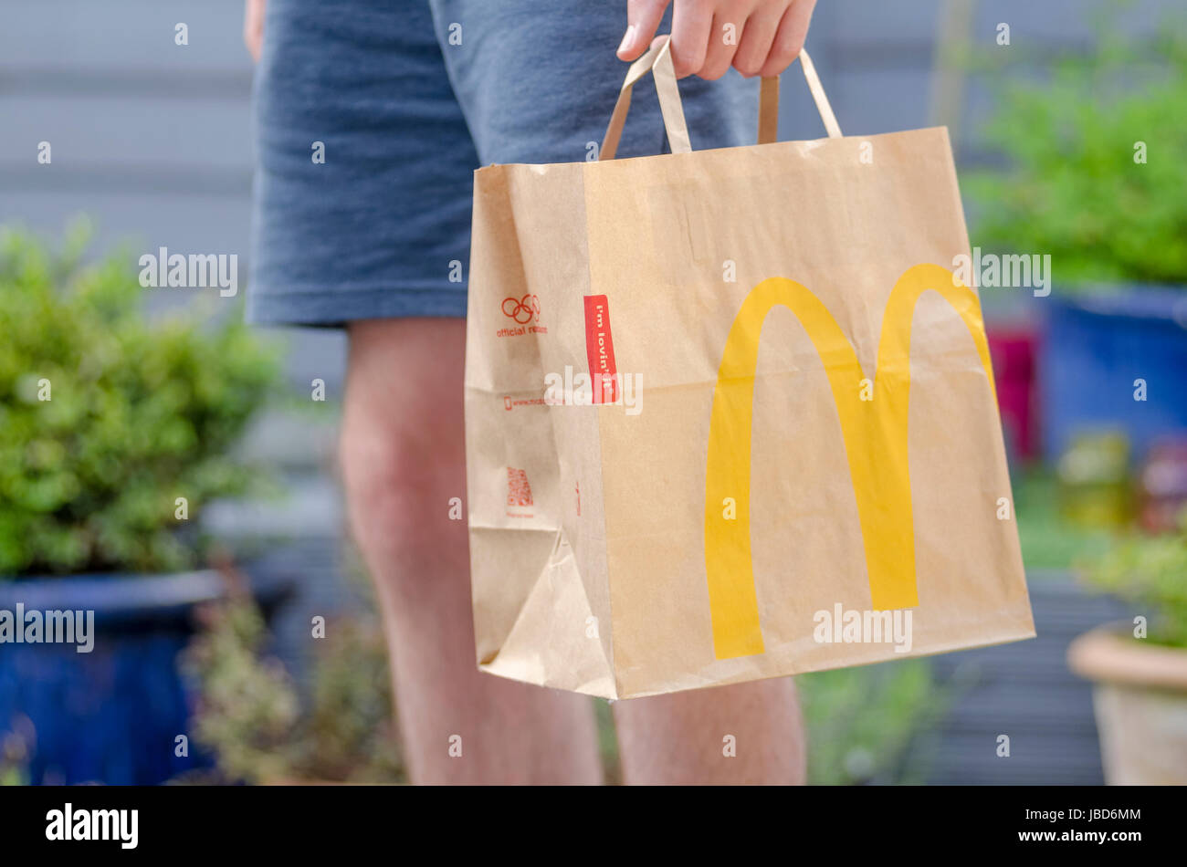 Close up of a McDonald's Take Away Food Brown Paper Bag,  McDonald's is a fast food restaurant chain founded - Stock Image