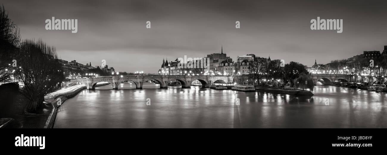 Black & White panoramic of Ile de la Cite, the Seine River and Pont Neuf at Dawn. Paris, 1st Arrondissement, - Stock Image