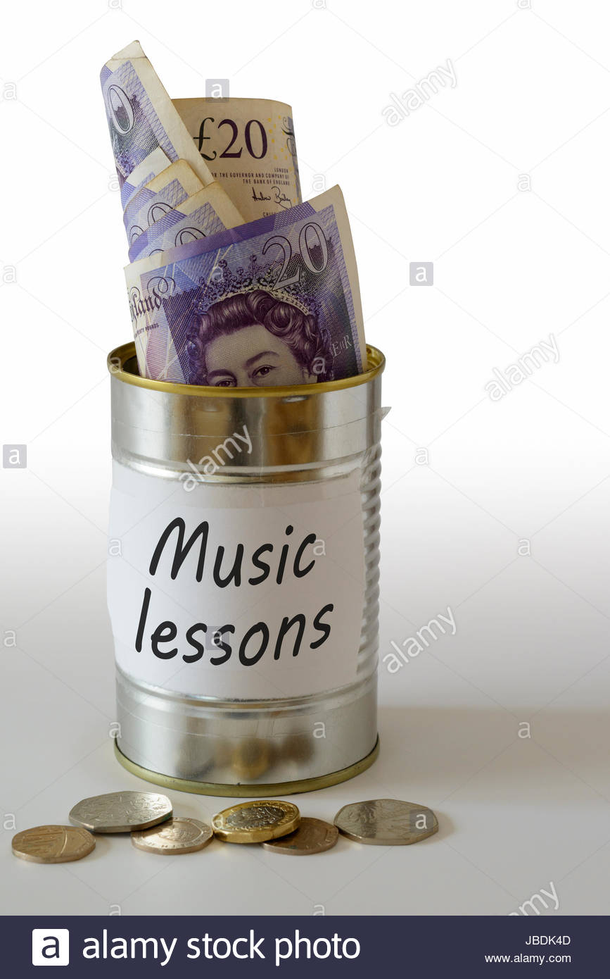Music lessons, cash kept in a tin can, England, UK Stock Photo