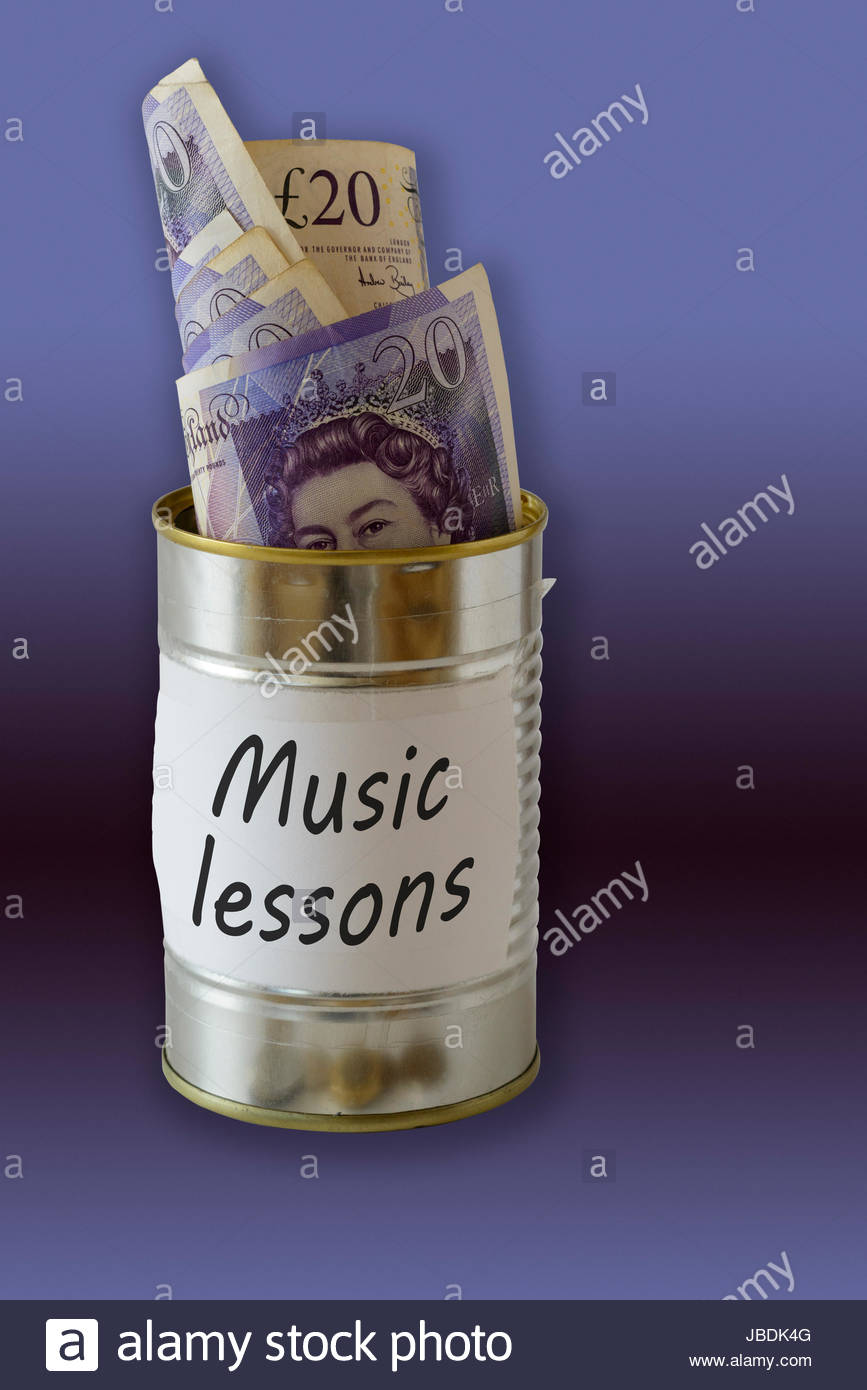 Music lessons, cash kept in a tin can, England, UK - Stock Image
