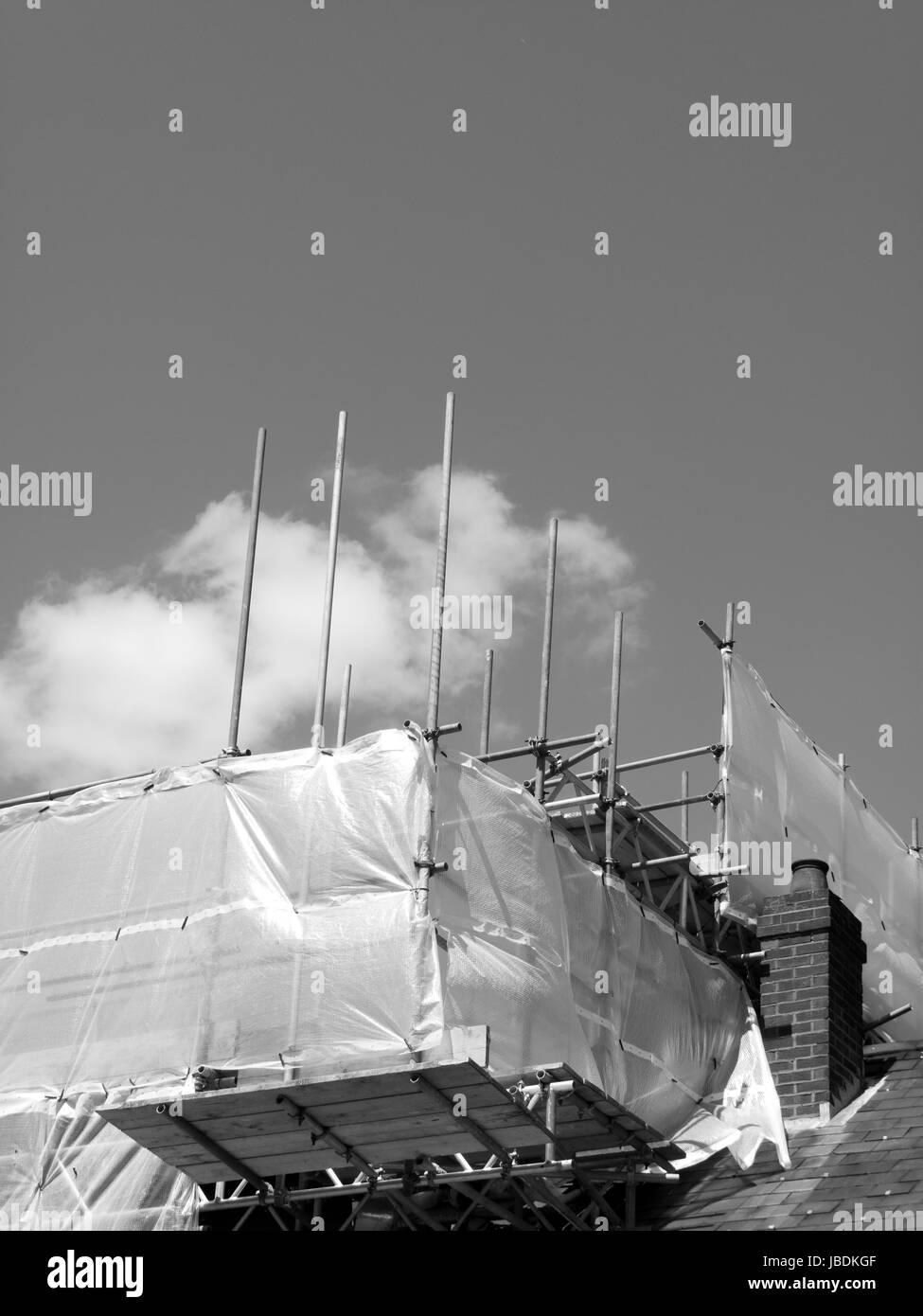 Rooftop contractors scaffolding over building development - Stock Image