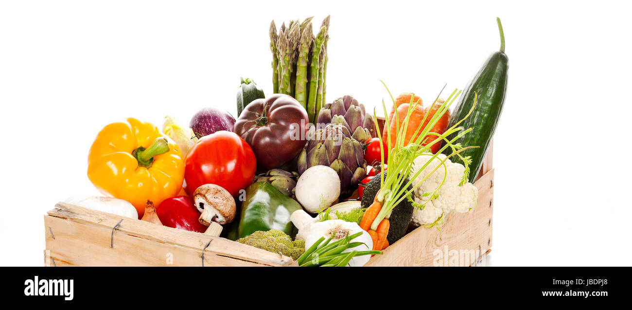 Assortment of fresh vegetables in a crate on white background Stock Photo