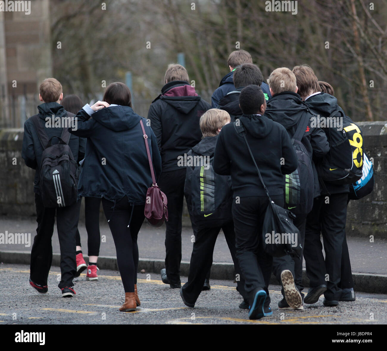 Anonymous school children in Scotland take time out during lunch break Stock Photo