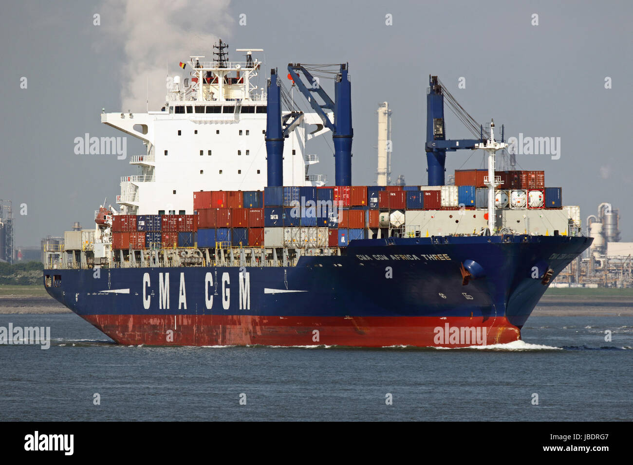 The container ship CMA CGM Africa Three passes Terneuzen and continues to the port of Antwerp. - Stock Image