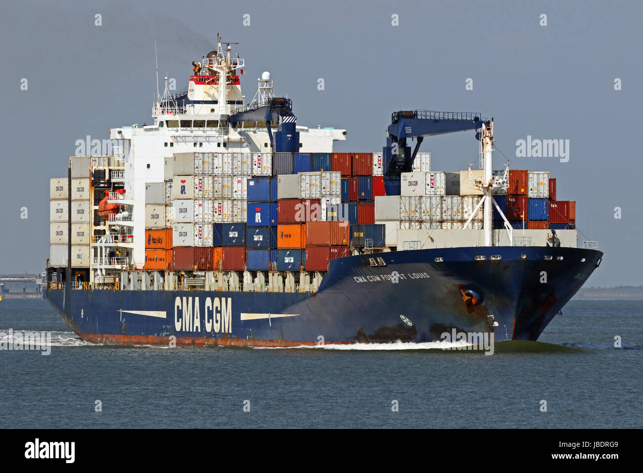 The container ship CMA CGM Fort Louis passes Terneuzen and continues to the port of Antwerp. - Stock Image