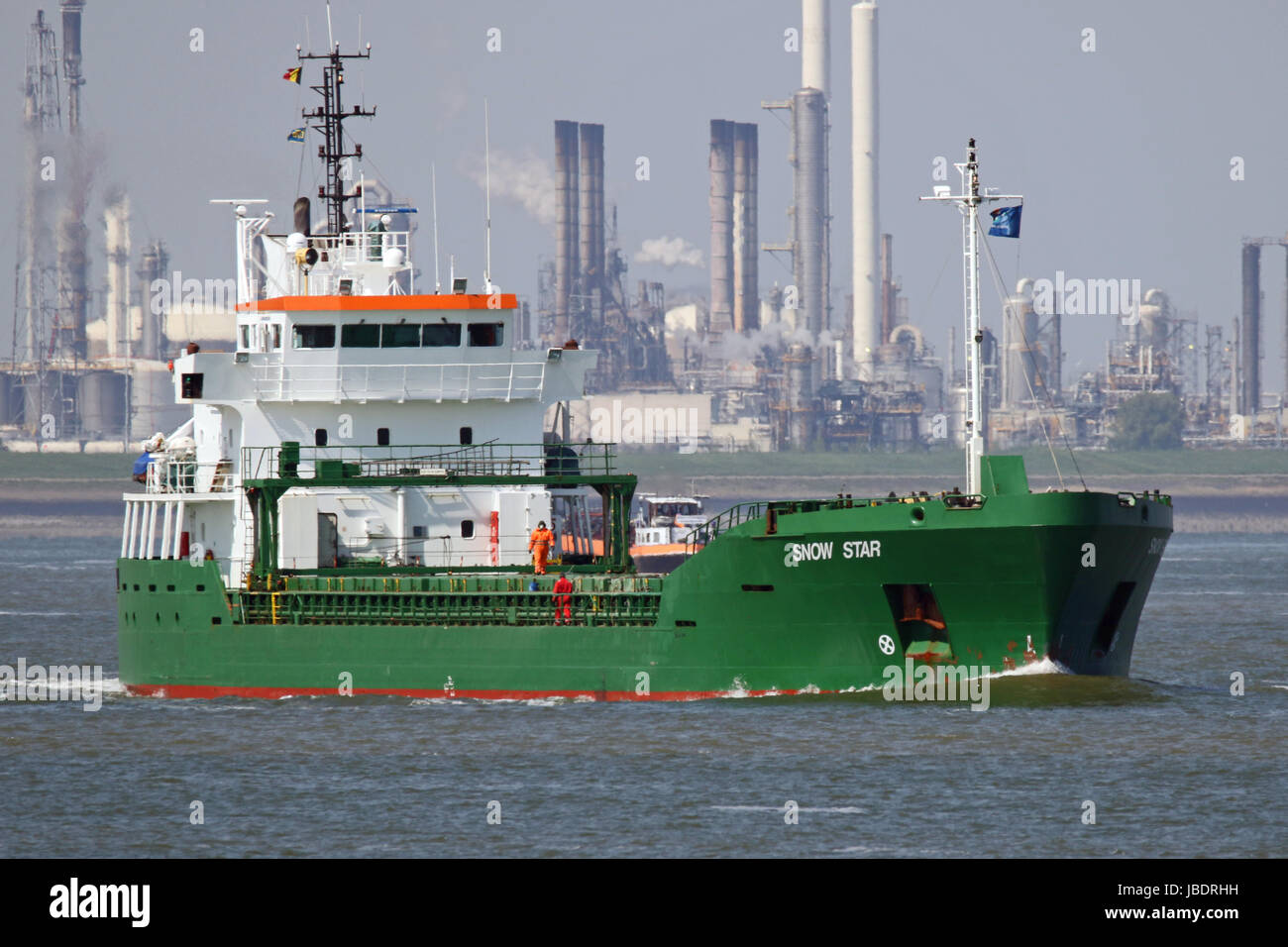 The general cargo ship Snow Star on the schelde river passing Terneuzen on the way to the port of Antwerp - Stock Image