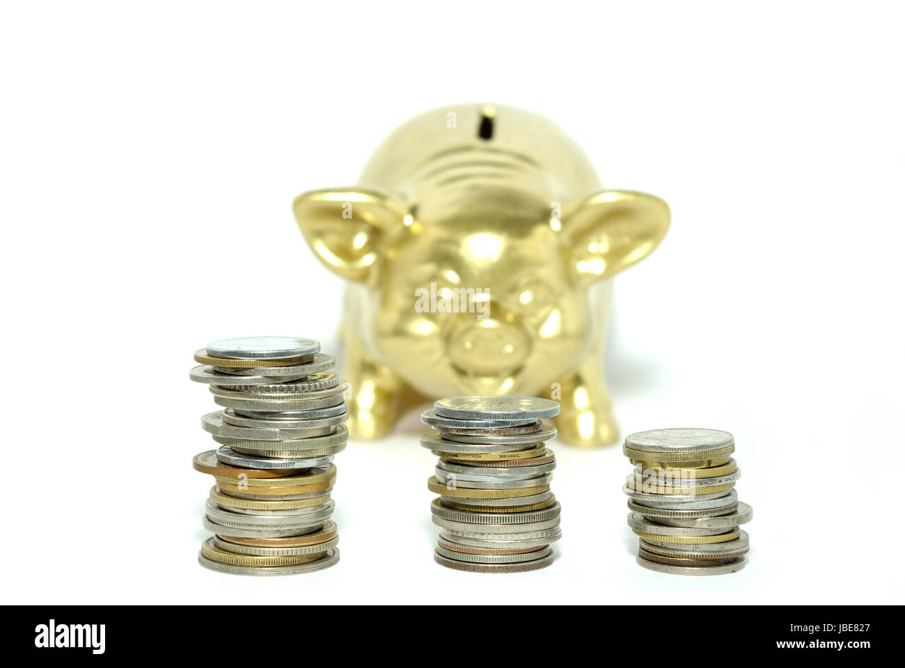 piggy bank  isolated on white background with coins Stock Photo