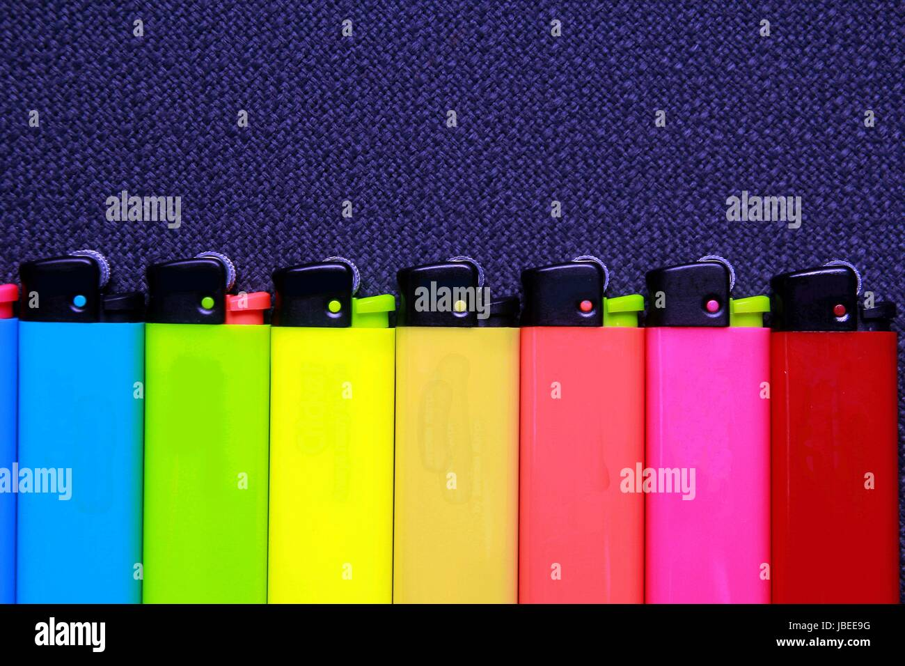 Photo of colorful cigarette lighters - Stock Image