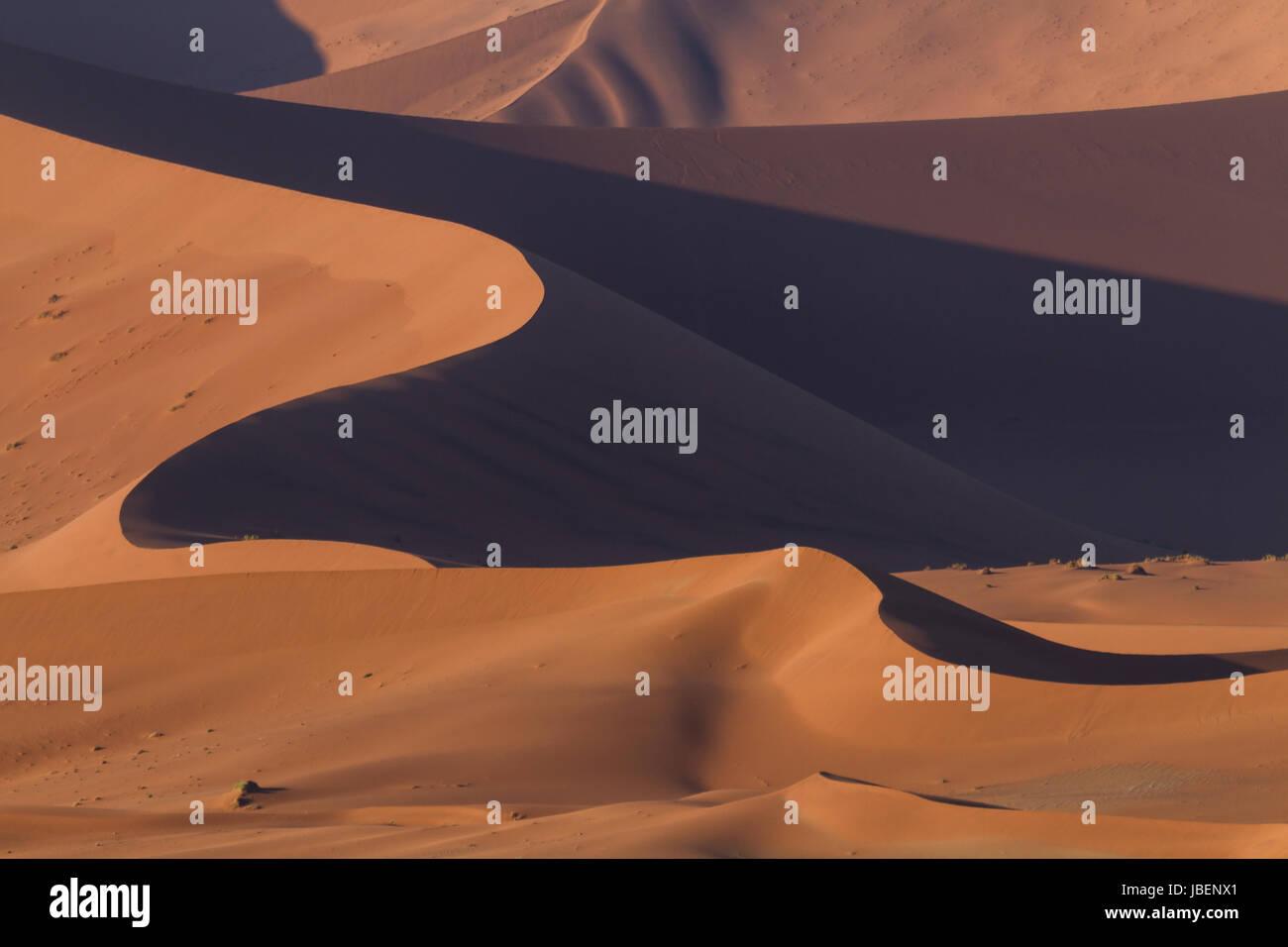 Waves of ornage dunes at Sossusvlei, Namibia, Africa - Stock Image