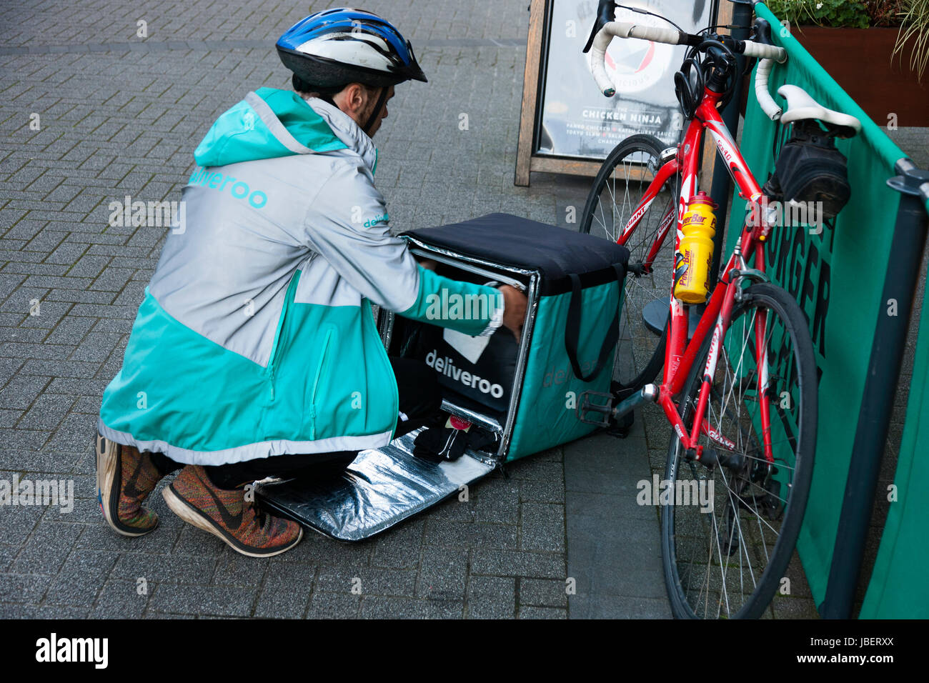 f165758c6fb Deliveroo takeaway food delivery Courier pedal cycle / push bike cyclist  making a delivery run in Royal Leamington Spa. U.K. (88)