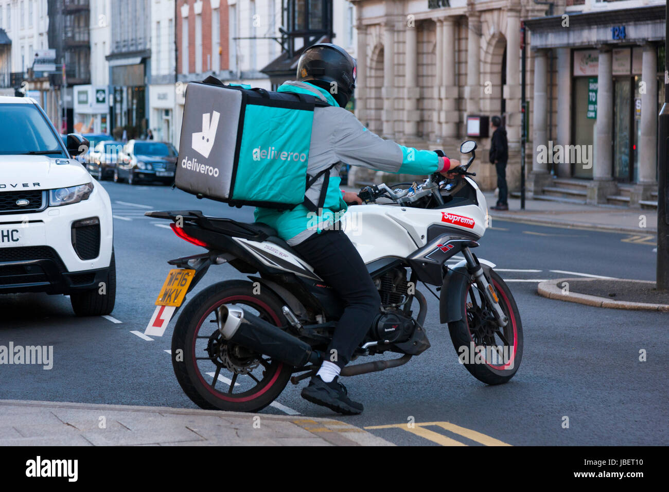 121df31c2be Deliveroo takeaway food delivery Courier Learner motor cyclist / cycle /  bike / biker making a delivery run in Royal Leamington Spa. U.K. (88)