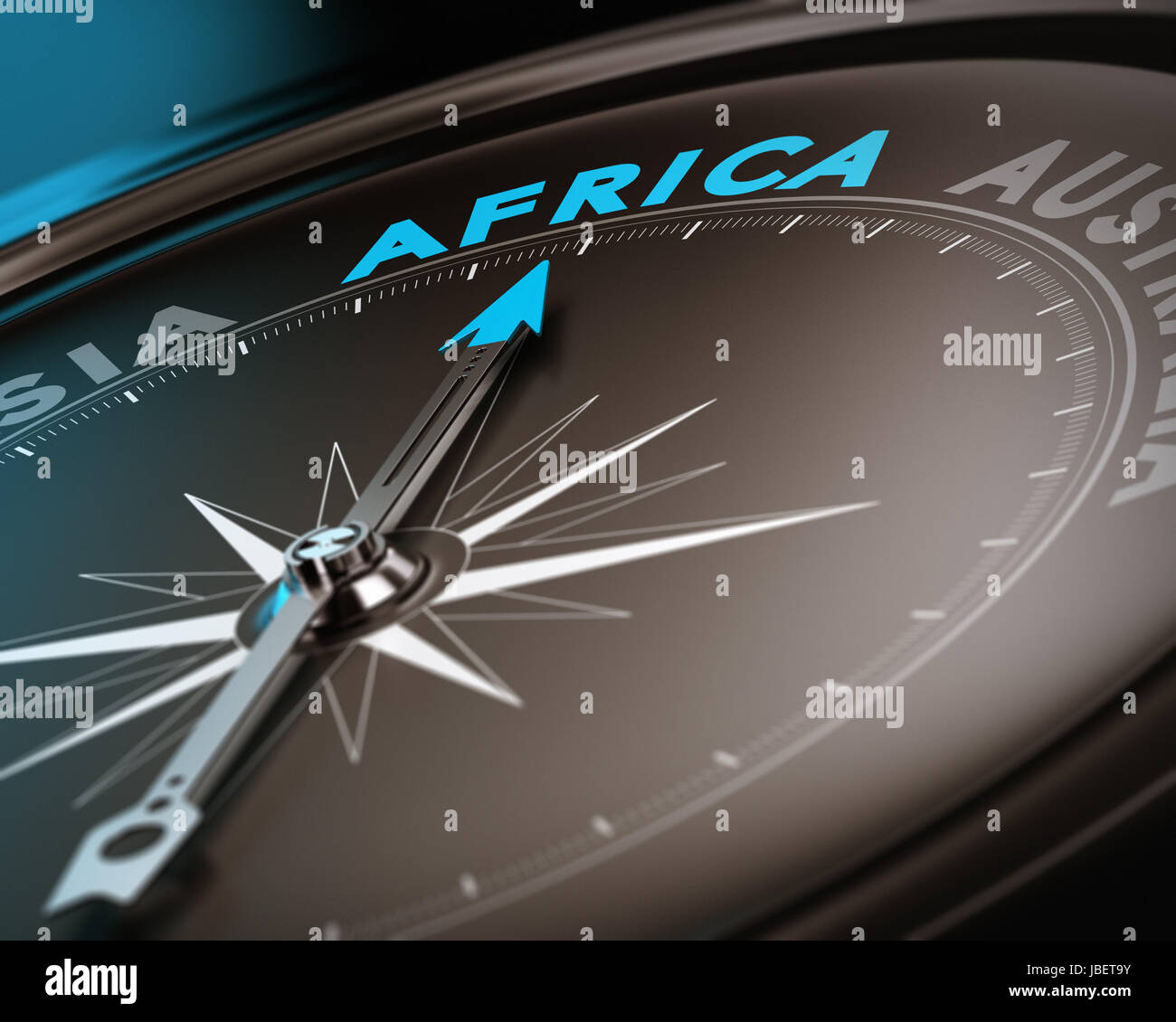 Abstract compass needle pointing the destination africa, blue and brown tones with focus on the main word. Concept - Stock Image