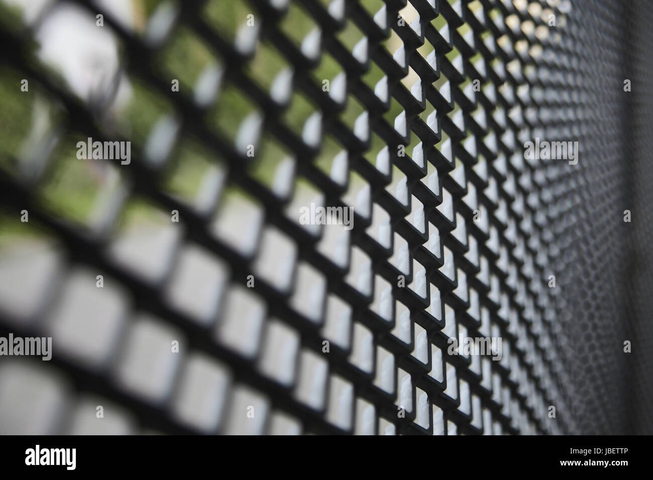 curved metal fence - Stock Image
