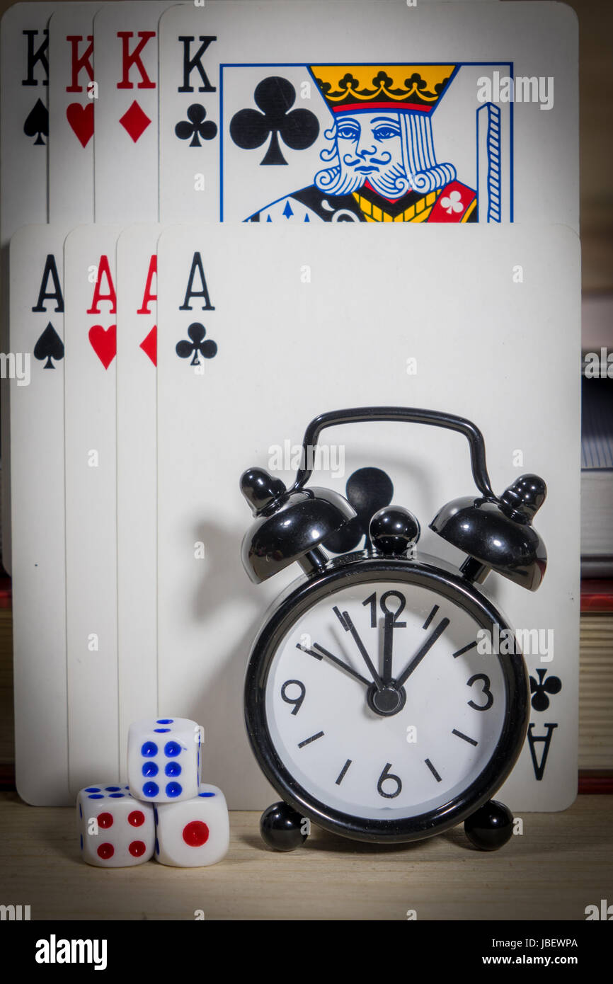 Poker of cards, dice, clocks,gambling with time. - Stock Image