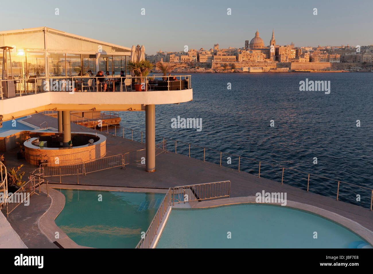 View from Sliema of Valletta, in front Restaurant The Terrace and Pool, Evening Light, Valletta, Malta - Stock Image