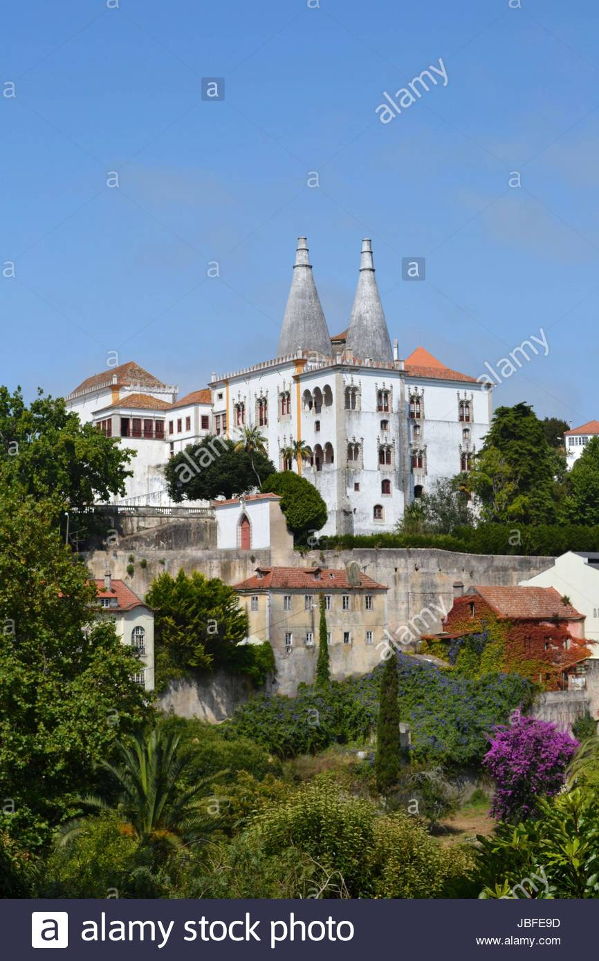 The beautiful castle in Sintra, Portugal. Nobody who went there will forget its big chimneys. - Stock Image
