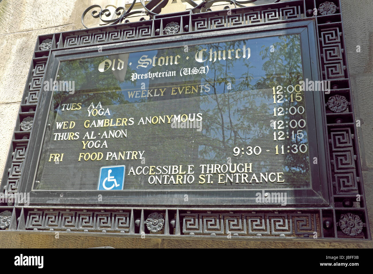 Sign outside Old Stone Church in Cleveland, Ohio shows non-secular weekly events geared towards the great Cleveland - Stock Image