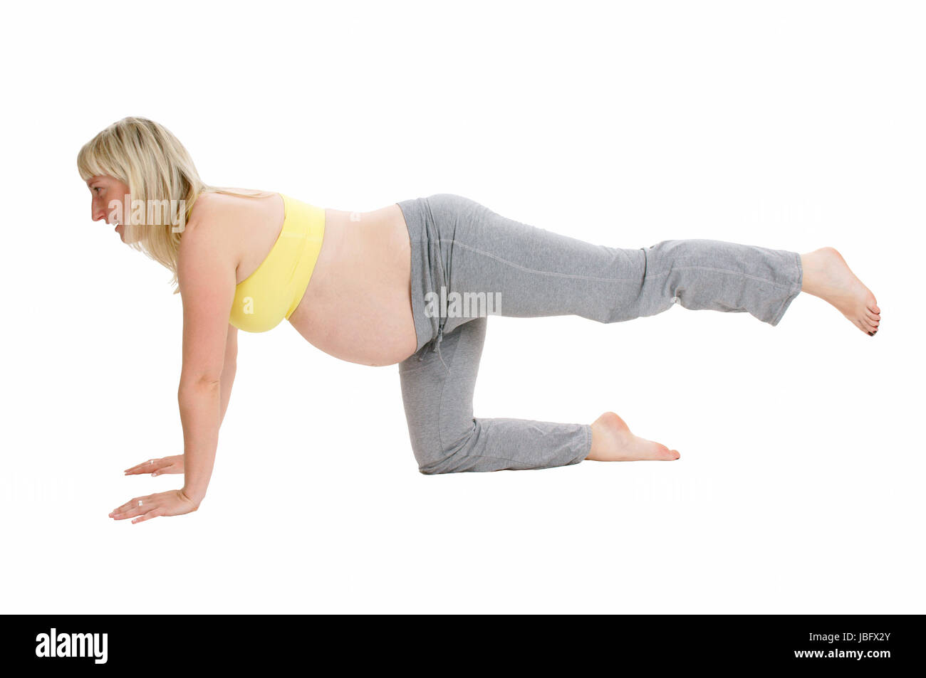 pregnant woman does sports - Stock Image