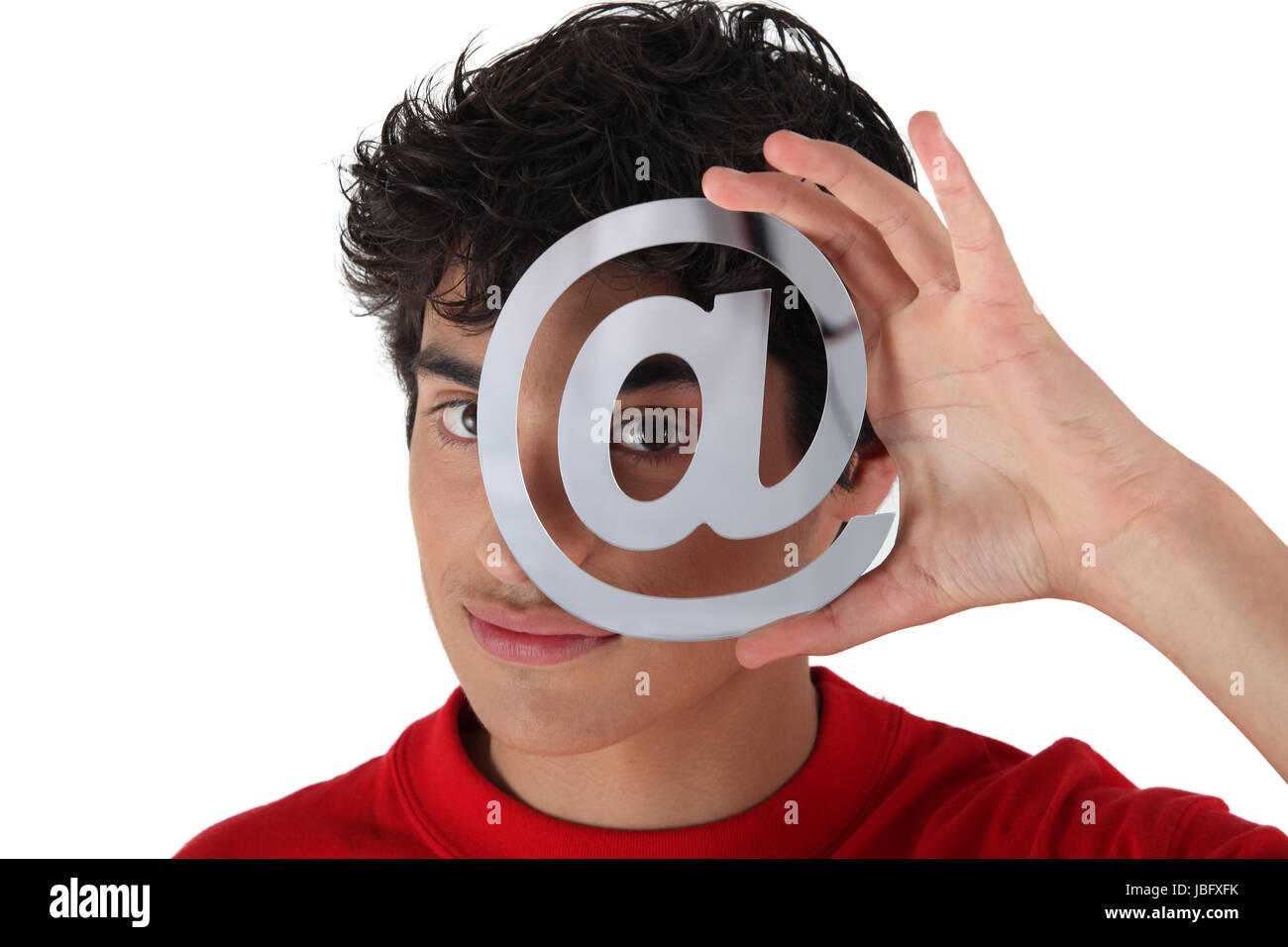 Young man with an @ sign - Stock Image