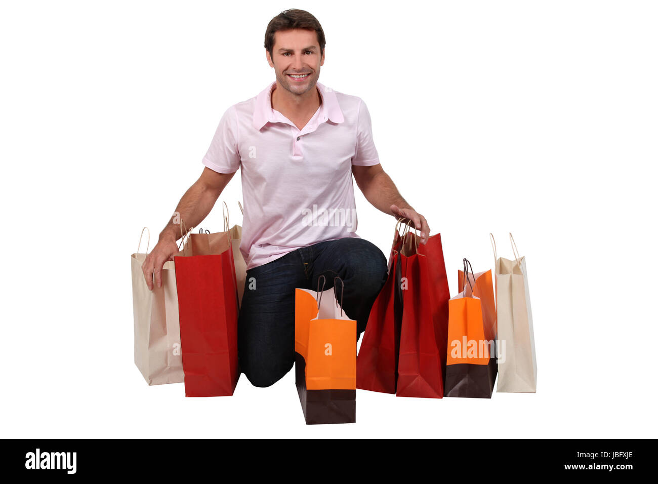 Man with shopping bags - Stock Image