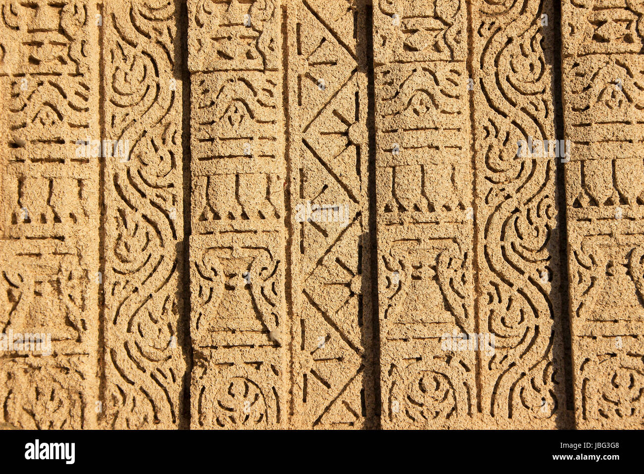 Intricately etched design bands on the wall of  Rukmini Temple on seashore at Dwaraka, Gujarath, India, Asia - Stock Image