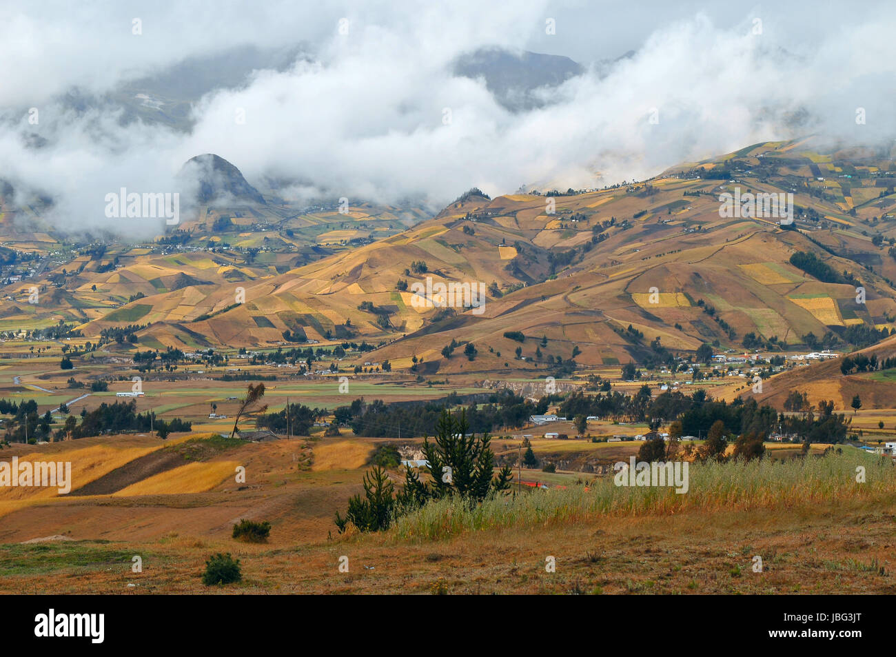 Clouds on the fields of Zumbahua in Ecuadorian Altiplano. Highland Andes near Quilotoa lagoon, South America - Stock Image