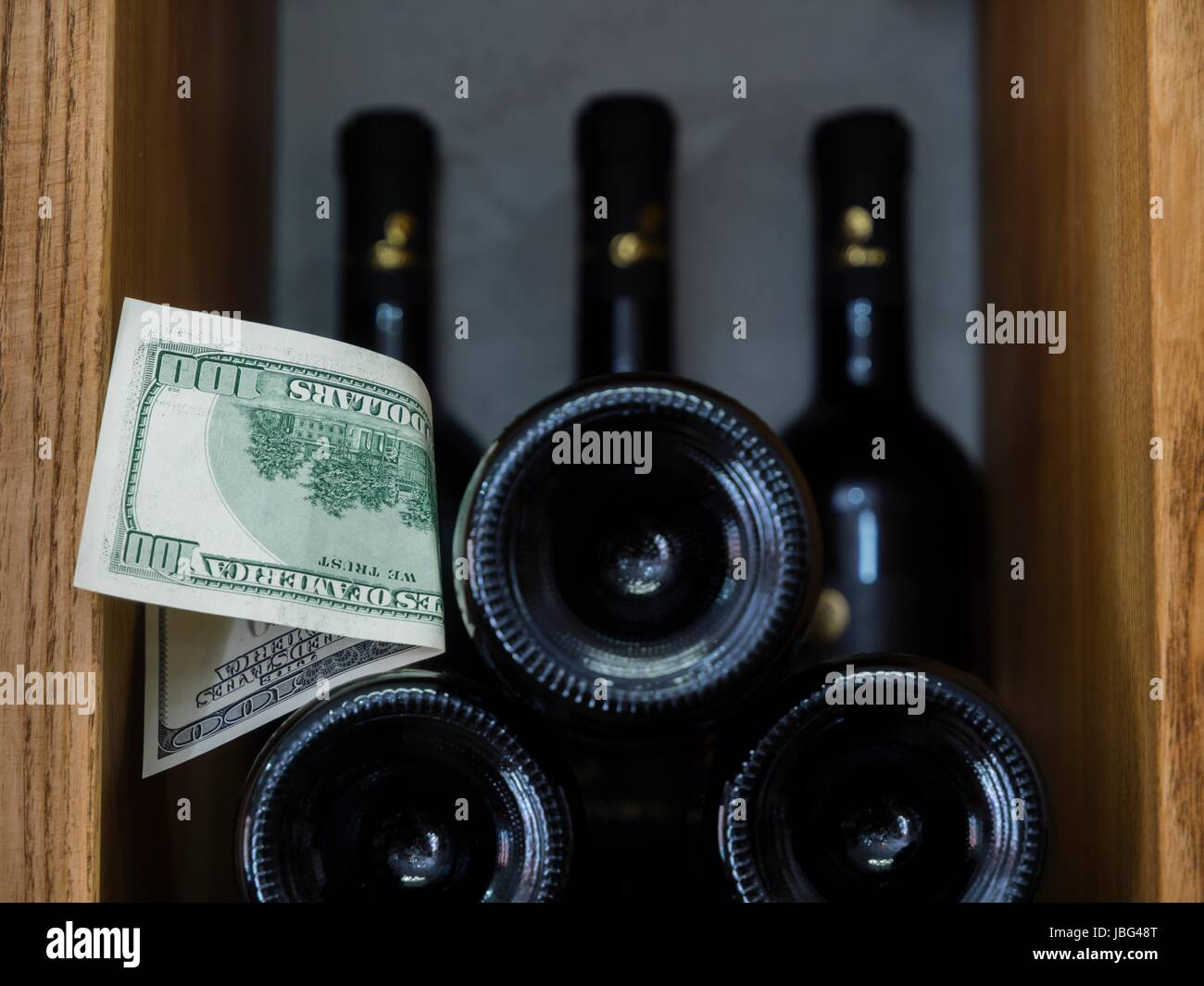 Wine cellar and dollars money - Stock Image