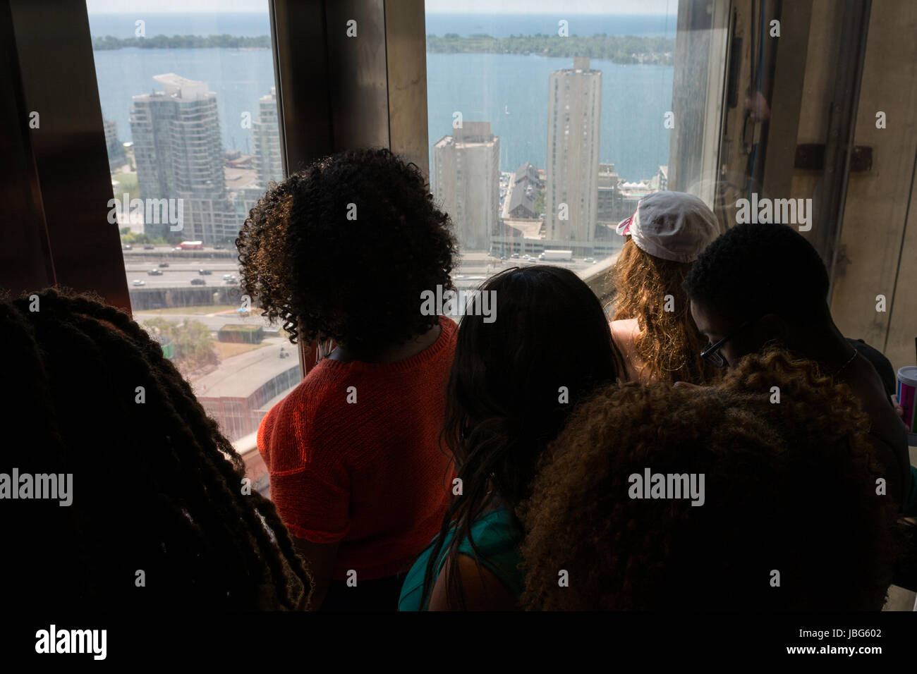 CN Tower Toronto glass elevator - Stock Image