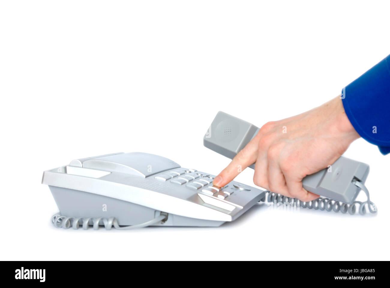 Finger presses figure on phone - Stock Image