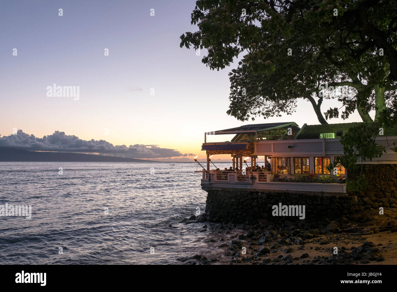 Tourists enjoying a sunset dinner in a restaurant on Front Street Lahaina Maui Hawaii Stock Photo