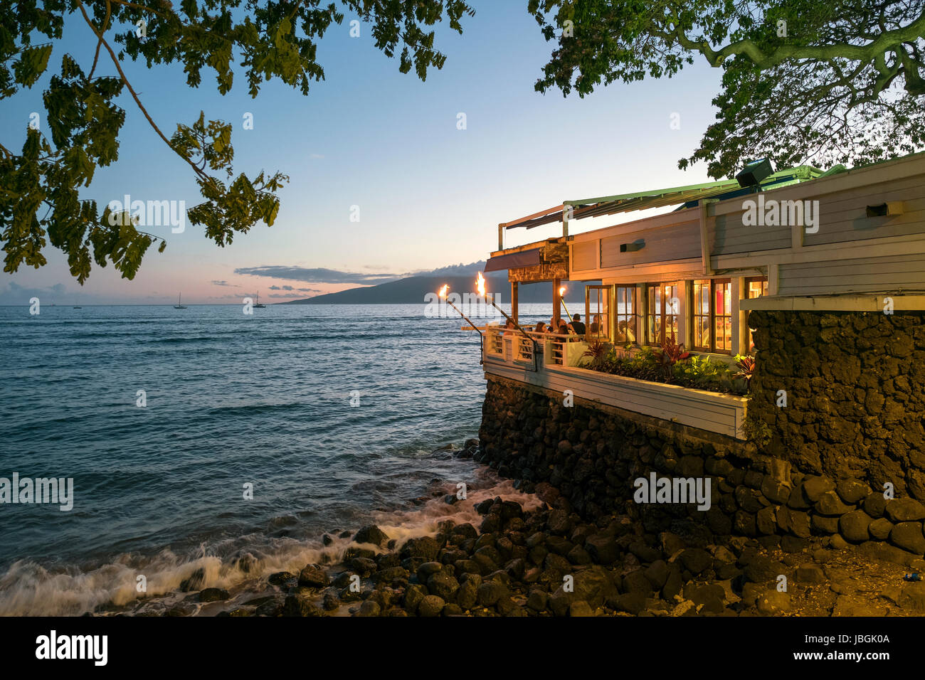 Tourists enjoying a sunset dinner in a restaurant on Front Street Lahaina Maui Hawaii - Stock Image