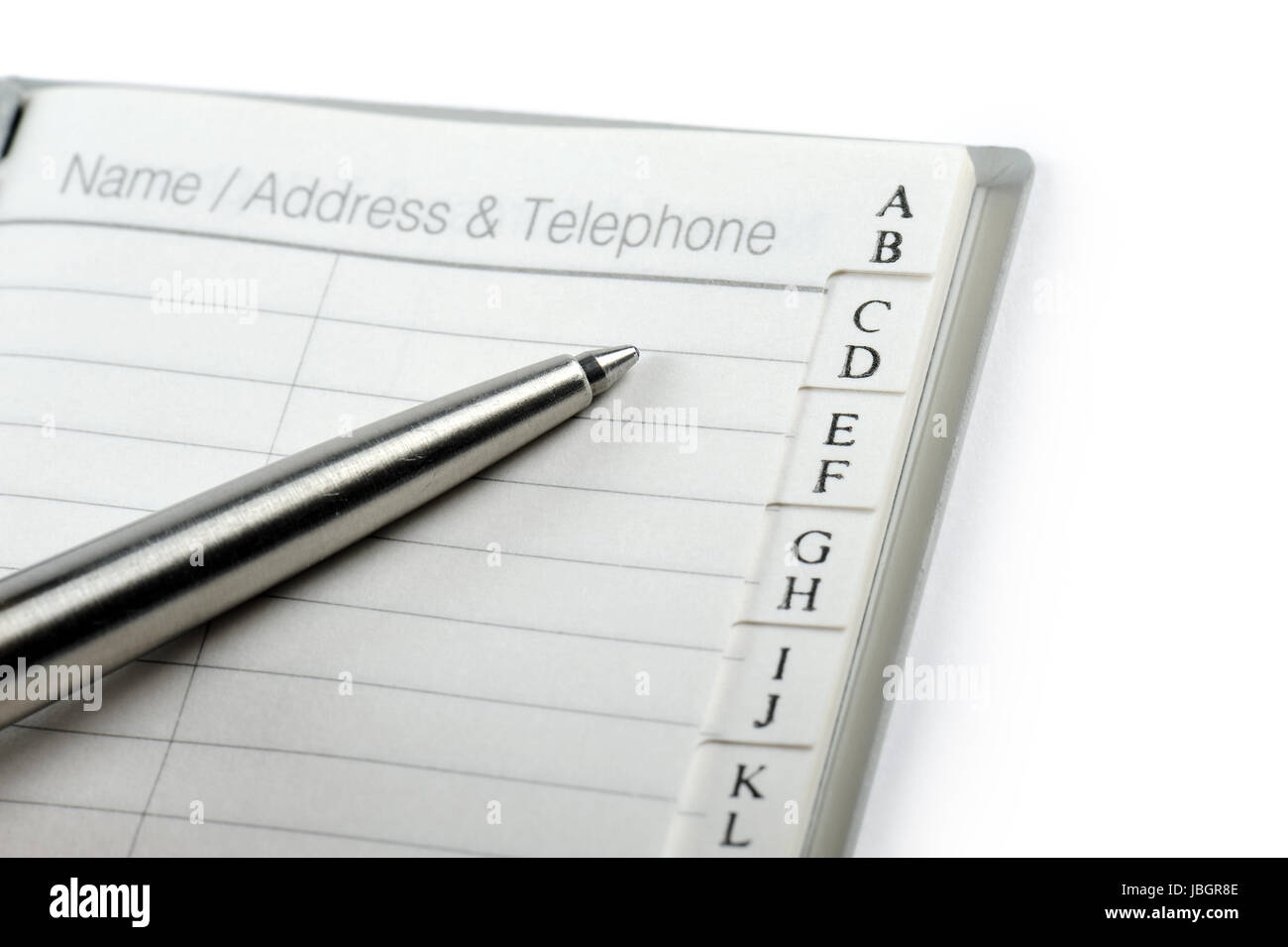 personal address book with ballpen on white background stock photo