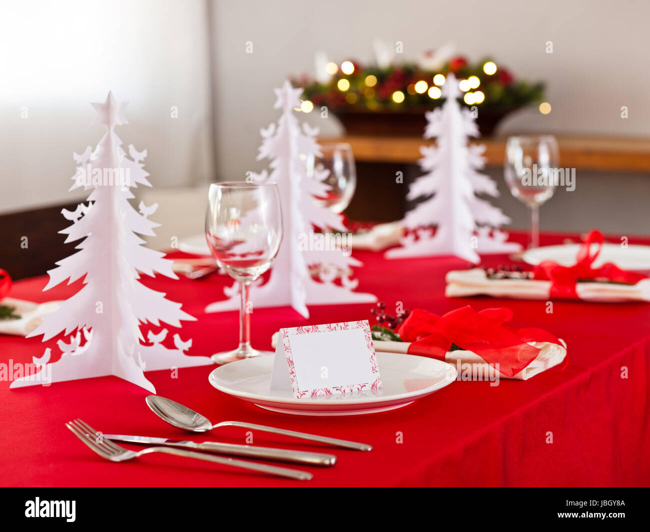 Christmas dinner table setting with name card in red Stock Photo ...