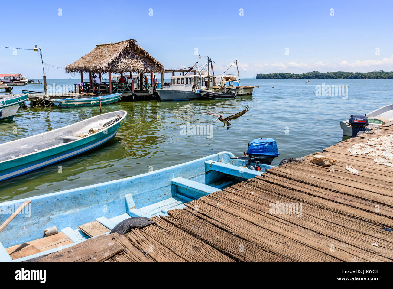 Livingston, Guatemala - August 31, 2016: Boats moored by dock in Caribbean town of Livingston - Stock Image