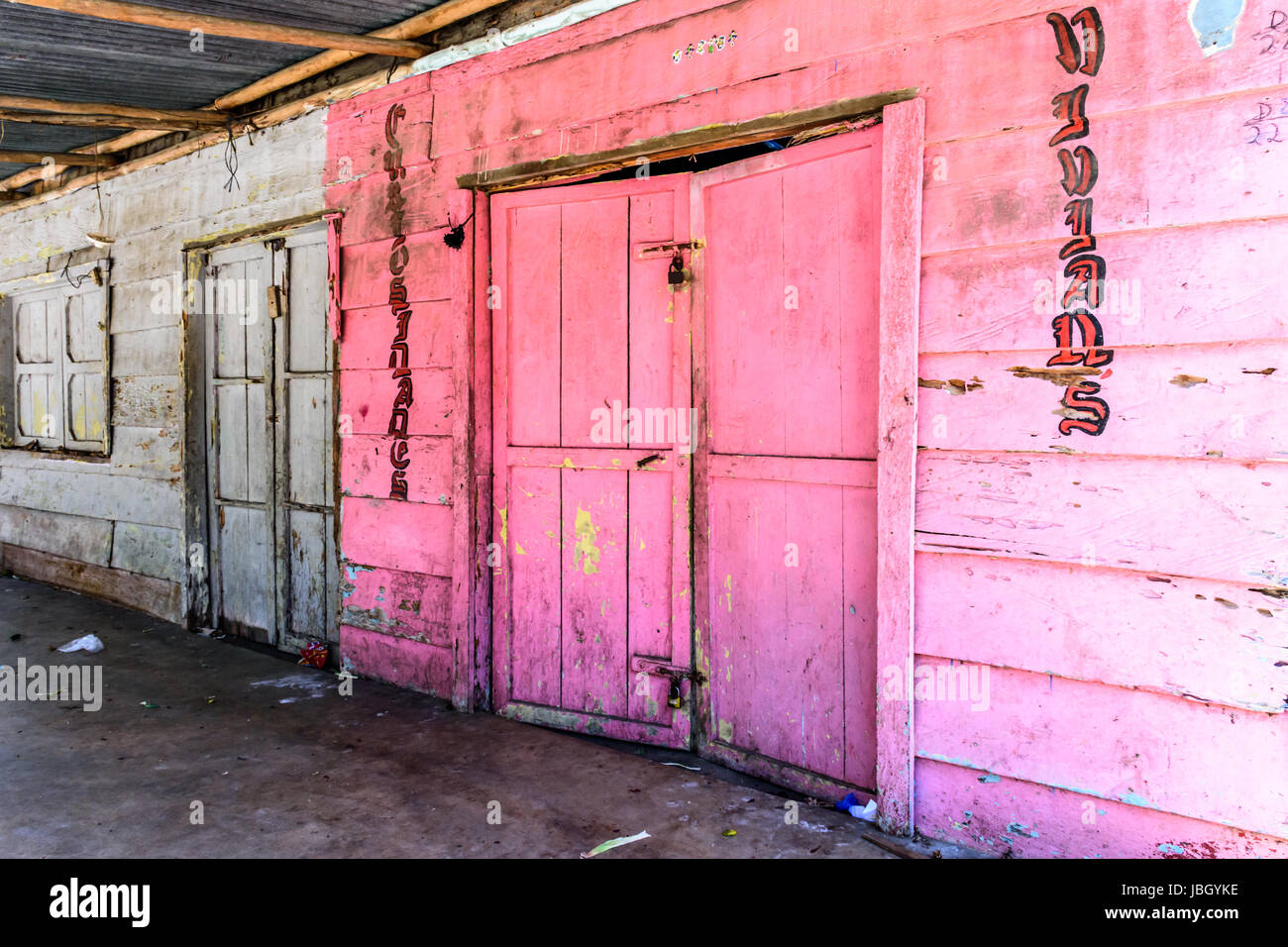 Livingston, Guatemala - August 31, 2016: Padlocked, colorful, wooden building in Caribbean town of Livingston - Stock Image