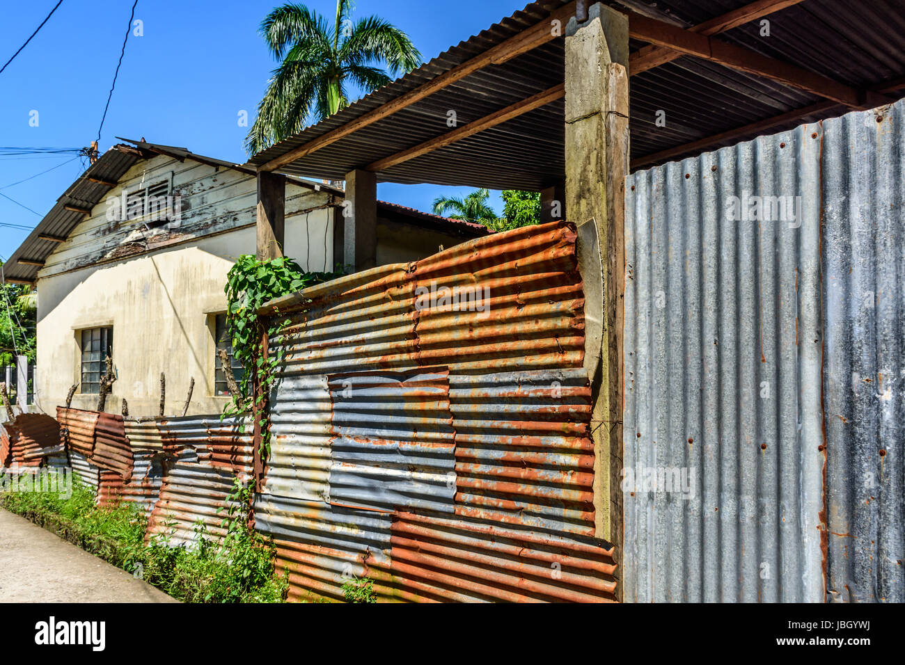 Livingston, Guatemala - August 31, 2016: Typical simple house with corrugated iron outbuilding in Caribbean town - Stock Image