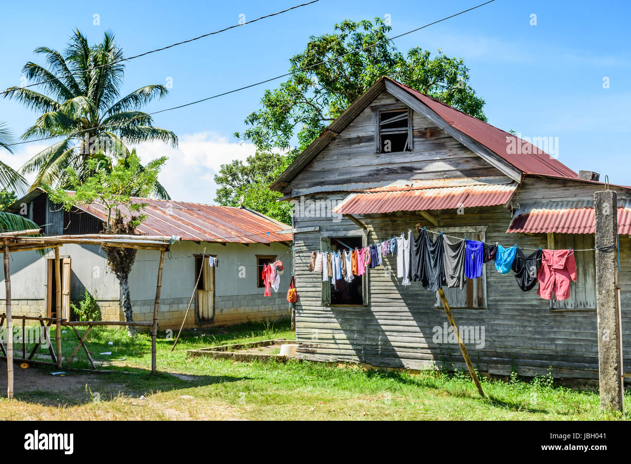 Livingston, Guatemala - August 31, 2016: Laundry hangs on washing line outside wooden house in Caribbean town of - Stock Image