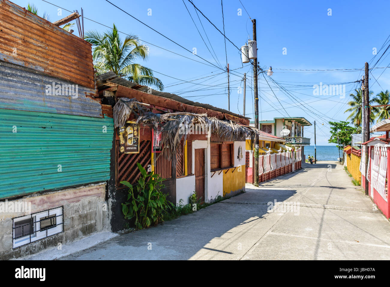 Livingston, Guatemala - August 31, 2016: Street leads down to water's edge in early afternoon in Caribbean town - Stock Image