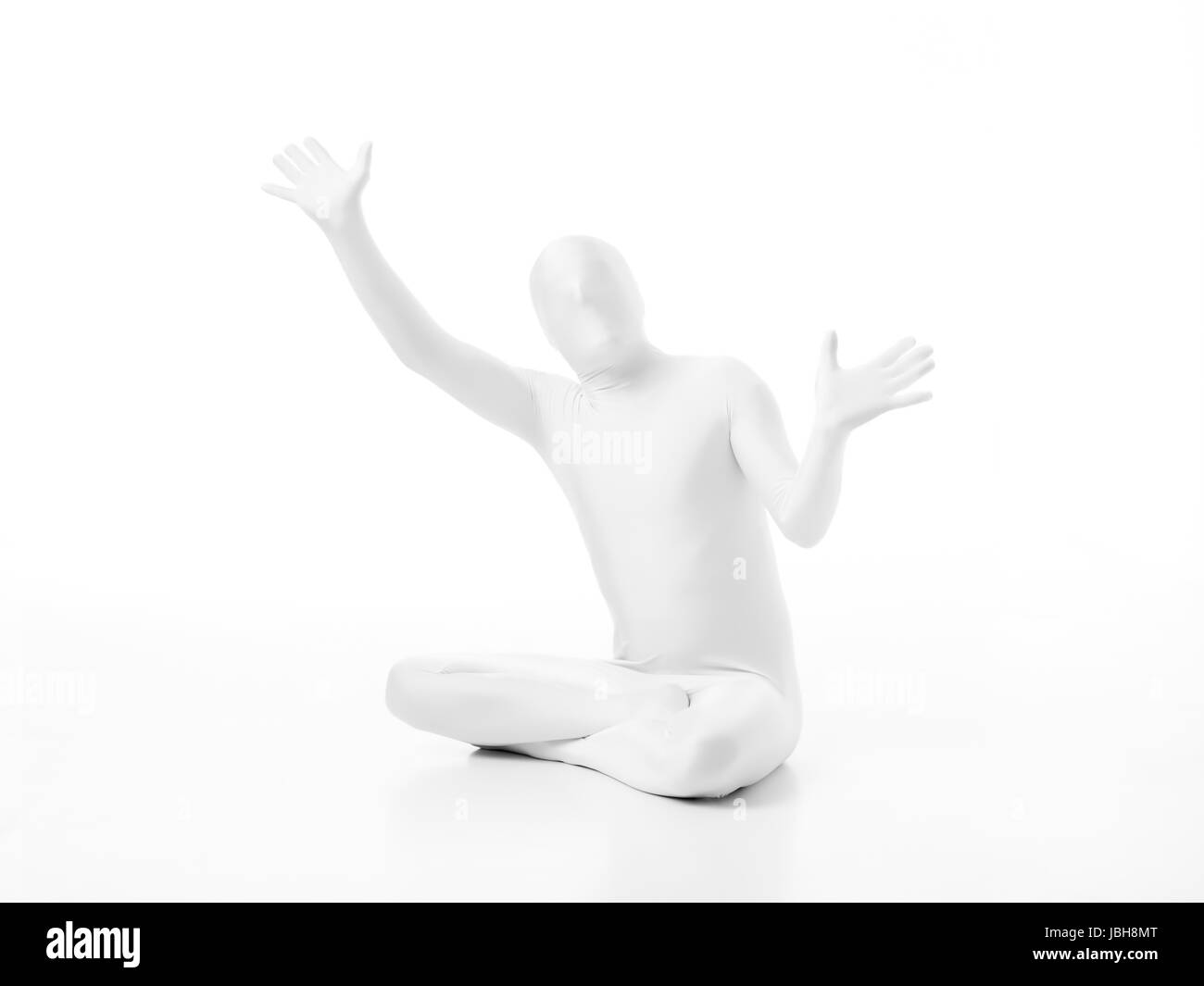 faceless man dressed  white with hands in position mime Stock Photo