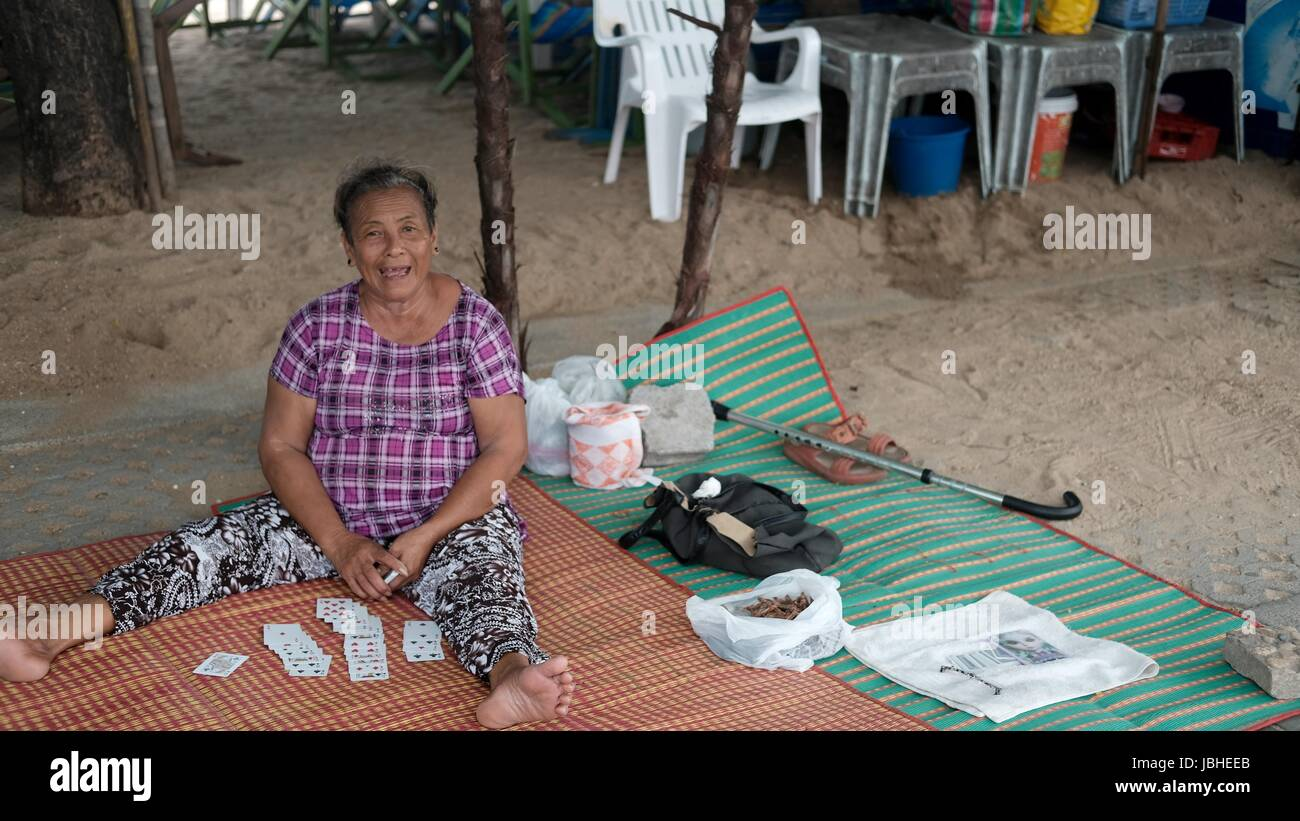 Old Lady Card Reader Fortune Teller selling on Beach Road Pattaya Chonburi Thailand Gulf of Thailand - Stock Image