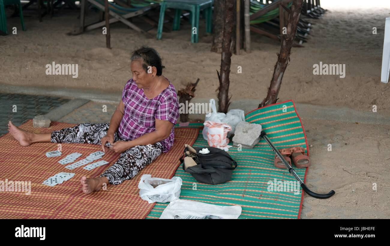 Old Lady Card Reader Fortune Teller selling on Beach Road Pattaya Chonburi Thailand Gulf of Thailand Stock Photo
