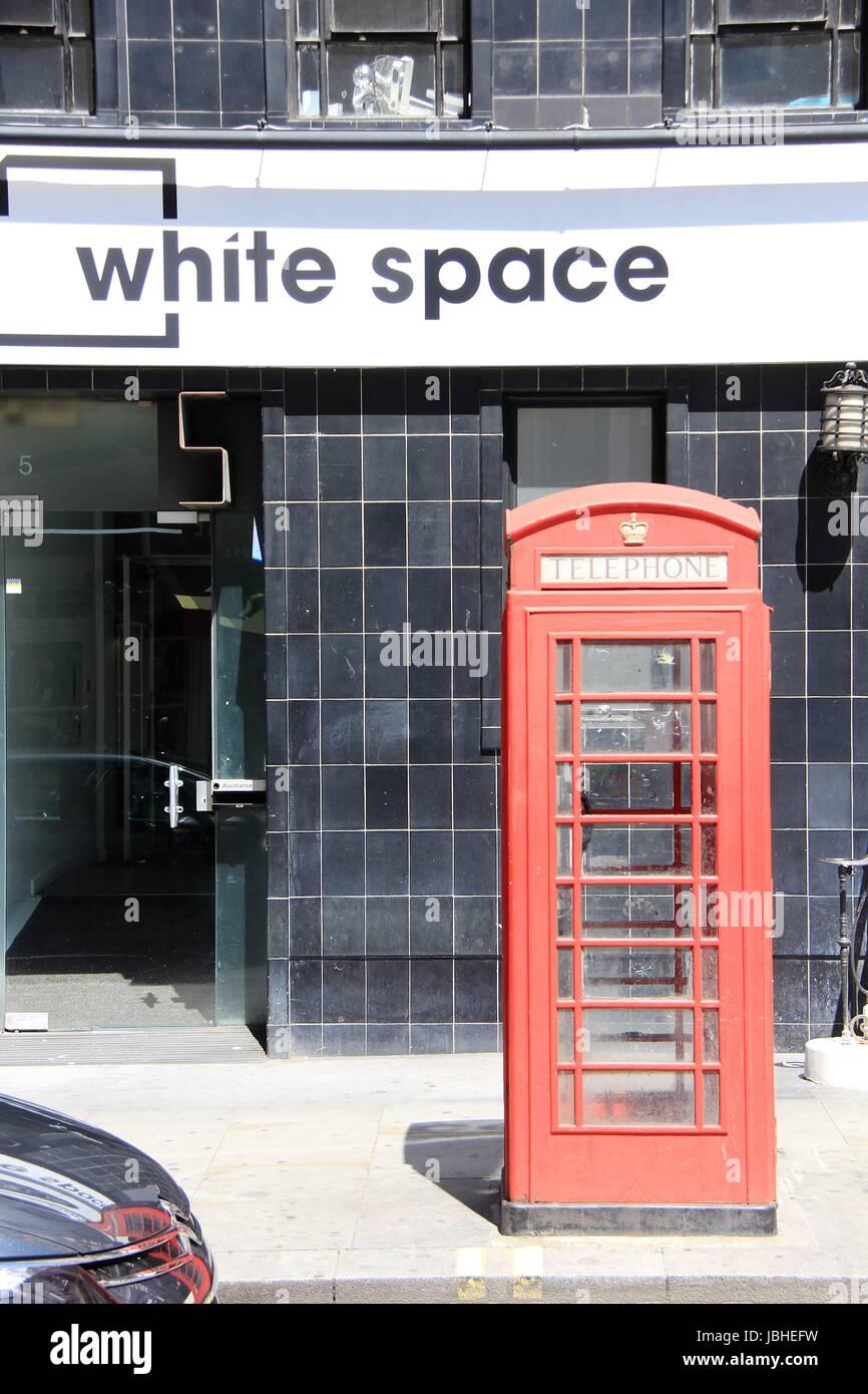 Traditional telephone kiosk in Central London - Stock Image